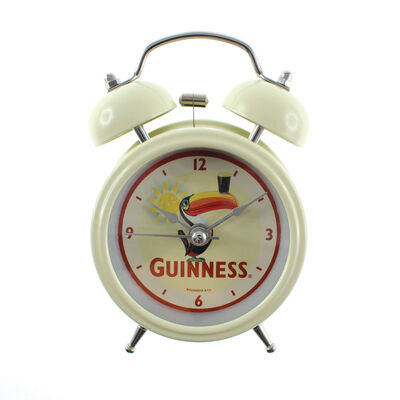Guinness Twin Bell Alarm Clock With Toucan And Bright Sun Background