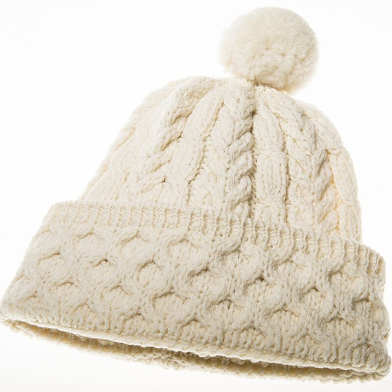 Honeycomb And Cable Knitted Woollen Hat With Pom-Pom In Cream